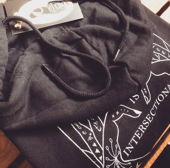 "Black Fairtrade with Zipper Backprint ""The Future is intersectional"""