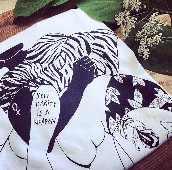 """Hand-printed Fairtrade sweater """"Solidarity is a weapon"""""""