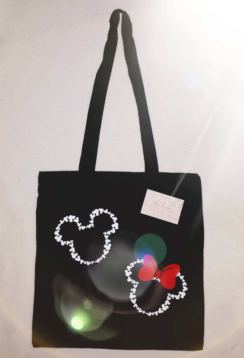 Tote bag adorned with a couple of famous mouse in cartoon-delivery available Slocrea