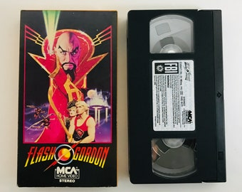 Flash Gordon, 1980 Sam J Jones, Melody Anderson vintage VHS vcr tape vintage movie classic home video action adventure free shipping (7140)M