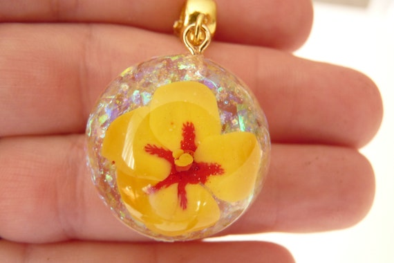Miniature Yellow Hibiscus in a Domed Pendant, With An Opal Background, On A Fine Gold Chain