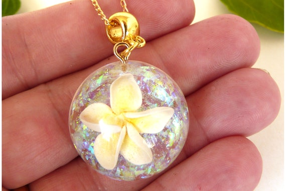 Delicate White Polymer Clay Frangipani Domed Pendant With Opal Background On A Fine Gold Chain