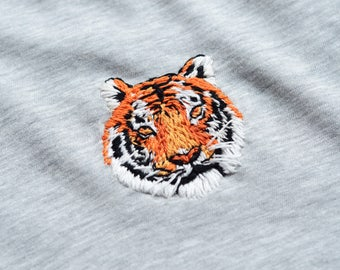 Embroidered tiger on grey tee. Wearable and fashionable embroidery design of fierce jungle animal