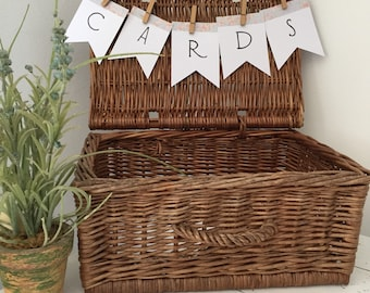 Hand crafted white and floral cards banner with twine and pegs