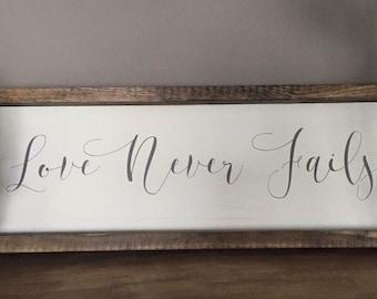 Love Never Fails Framed Wood Sign Decor