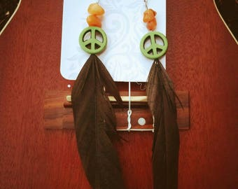 Green peace sign feather earrings