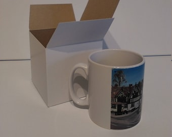 Sandbach Cobbles ceramic drinking mug featuring artwork by Christian Turner