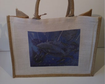 The Sardine Run jute shopper bag featuring artwork by Christian Turner