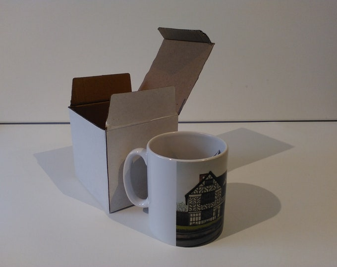 Churche's Mansion ceramic drinking mug featuring artwork by Christian Turner