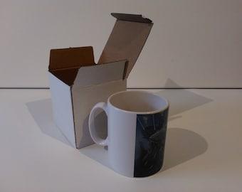 The Sardine Run ceramic drinking mug featuring artwork by Christian Turner