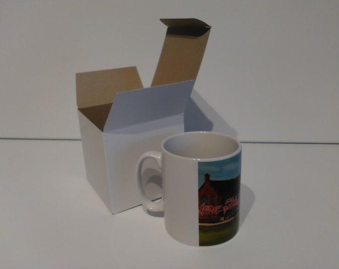 Sandbach School ceramic drinking mug featuring artwork by Christian Turner