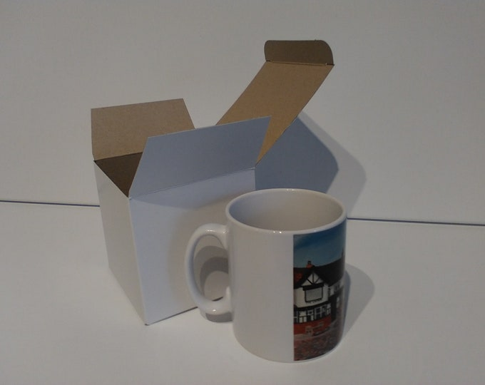 Sandbach Crosses ceramic drinking mug featuring artwork by Christian Turner