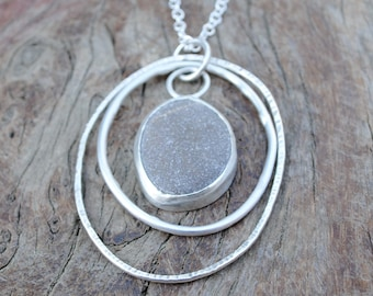 Multi-Hoop Pebble Pendant.