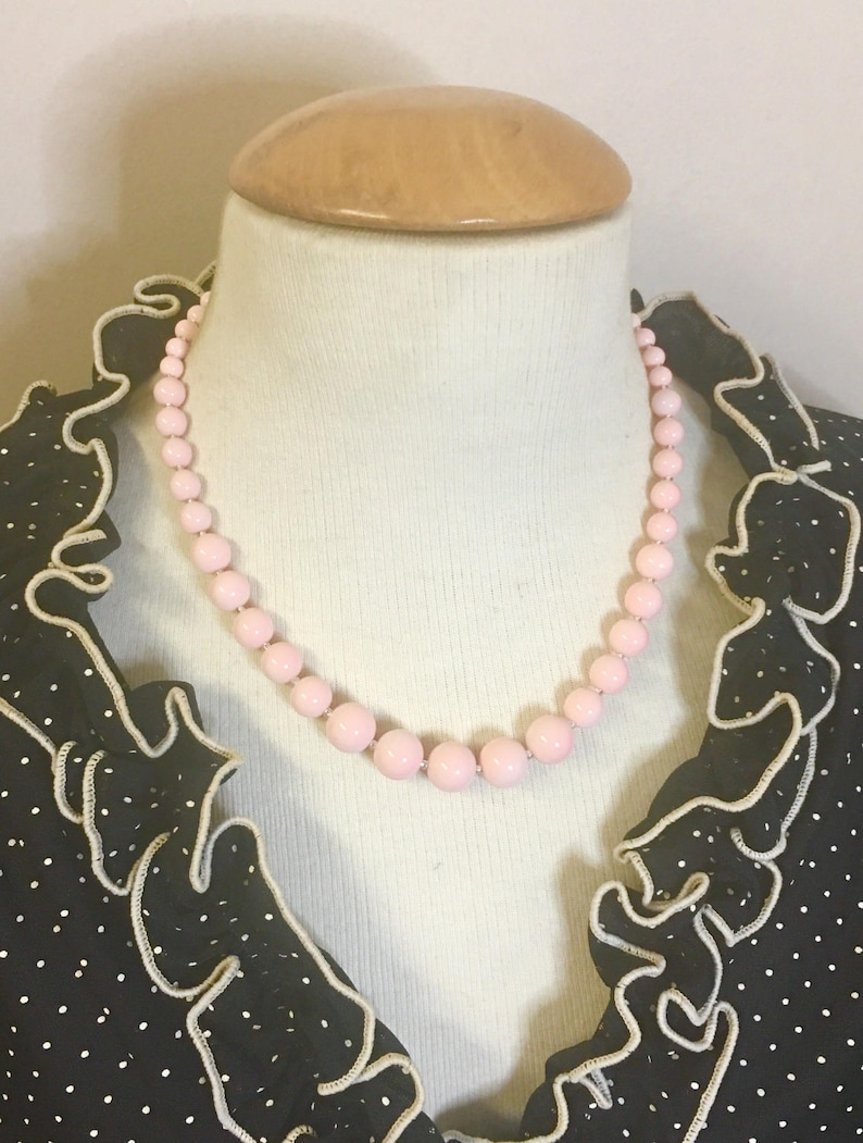 Darling Retro inspired graduated glass bead necklace in dreamy shell pink by Seditious Jewelry