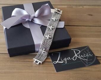 Sterling Silver Fleur de Lis Woven Bracelet