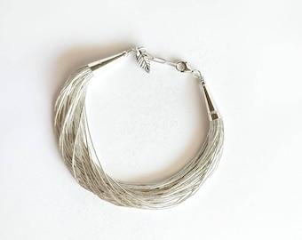 30 Strands Liquid Silver Bracelet