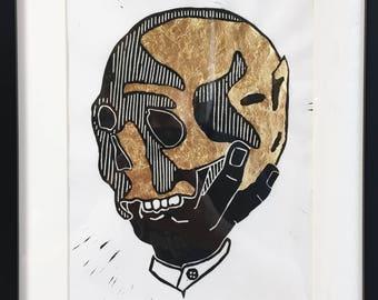 Hand Holding Skull Linocut Print