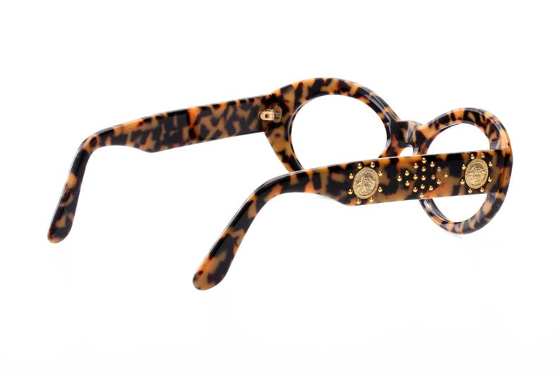 italian high fashion model from the 90s super gently used Versace sunglasses frames leopard cello enriched by golden sculptural appliques