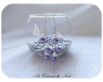 Purple and white earrings dangling