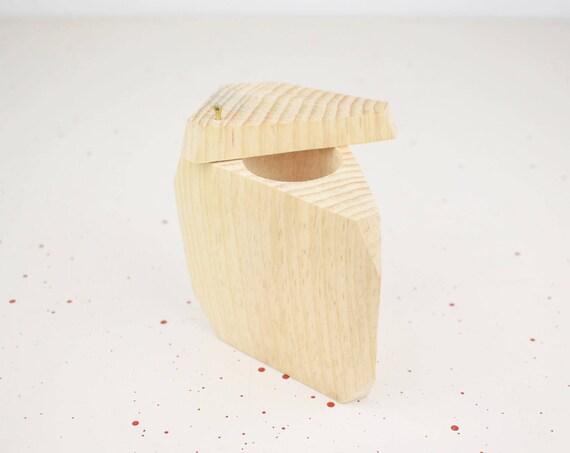 Triangular wooden box made of pine.