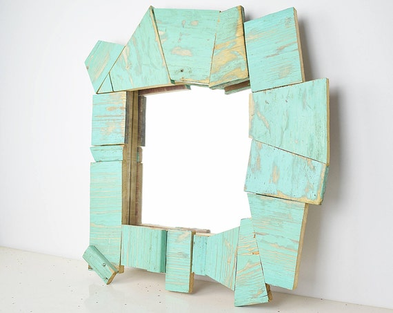 Prism. Abstract mirror frame, turquoise blue, polygonal trimmings of antique furniture. For make-up and ornamental.