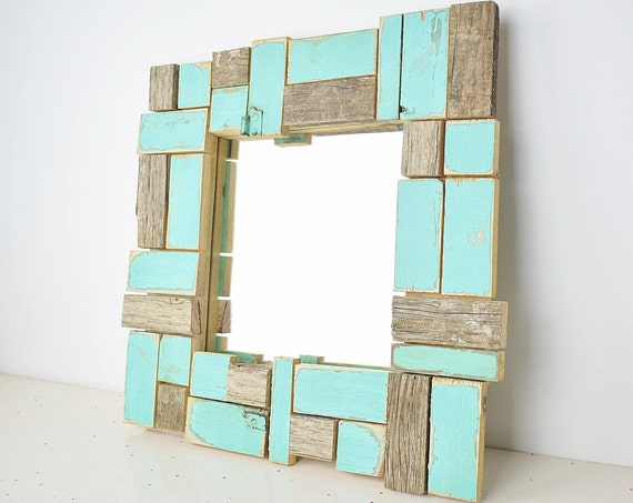 Fewe. Mosaic mirror frame, turquoise blue, antiqued wood polygonal cutouts. For make-up and ornamental.