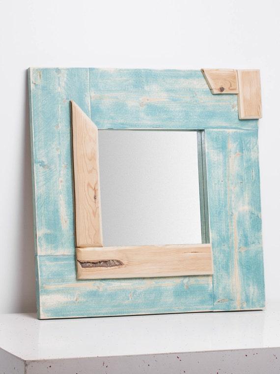 Heme. Turquoise mirror frame pastel.