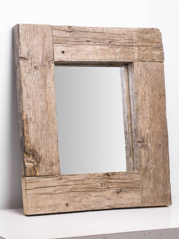 Ancient. Old wooden rustic mirror frame.