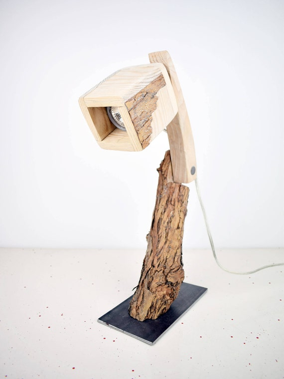 Rind. Adjustable wooden lamp. Table and desk. Office, study. Tree branch.