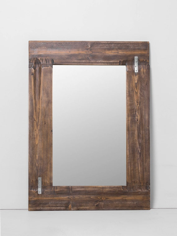 Blet. Rustic mirror frame with staples.