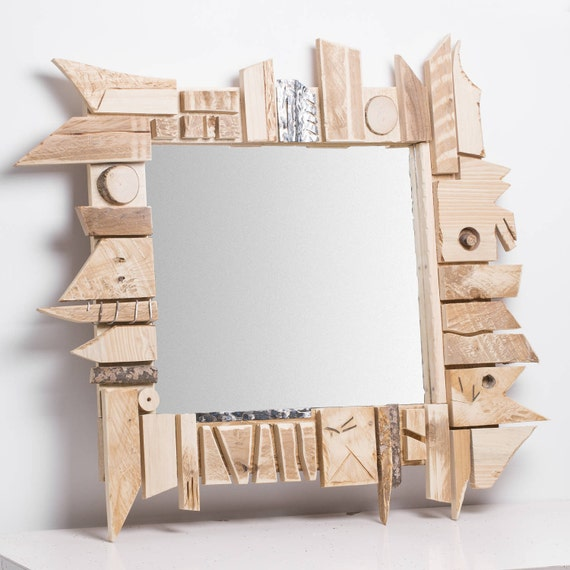 Ongle. Abstract mirror frame in wood and aluminium, polygonal trimmings of antique furniture.