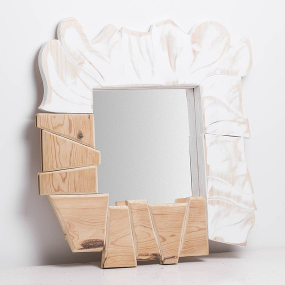 Coga. Mirror frame. Polygonal pieces natural color and circular white.