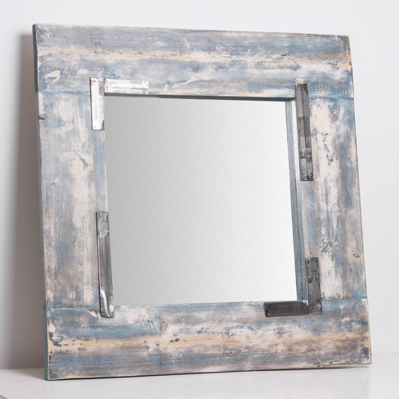 Teom. Mirror frame in wood and aged steel. Blue, ash and white.