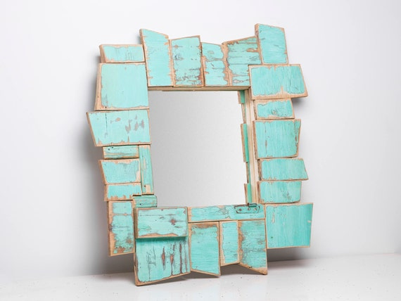 Wisp. Abstract mirror frame, turquoise blue, polygonal trimmings of antique furniture. For make-up and ornamental.