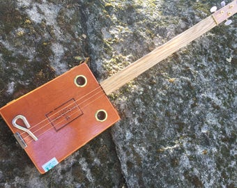 Acoustic Cigar Box Guitar. Beautiful box! Great gift for a guitarist!