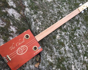 Acoustic Chisel Cigar Box Guitar. Convertible (opens up to put stash, picks slides etc!)  Oak fretboard. Great gift for a guitarist!