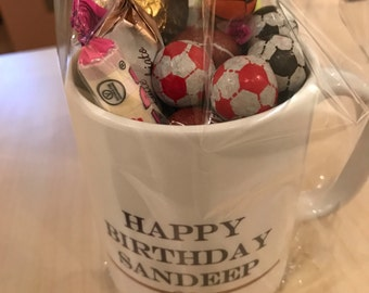 Personalised mug filled with candy
