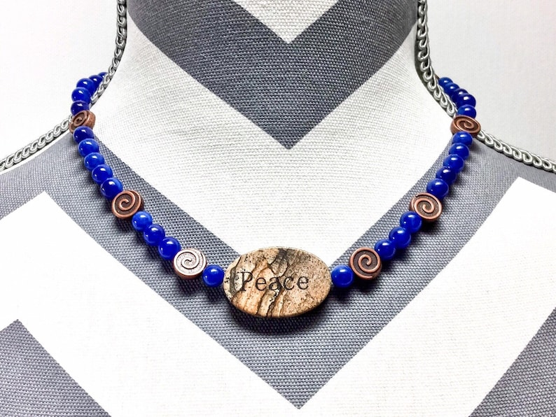 Peace granite focal on cobalt blue jade necklace with matching earrings