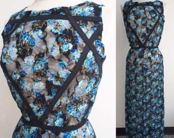 Fishnet dress with blue and black flower patterns, stretch polyester fabric, elasticated patterns representing the symbol of water