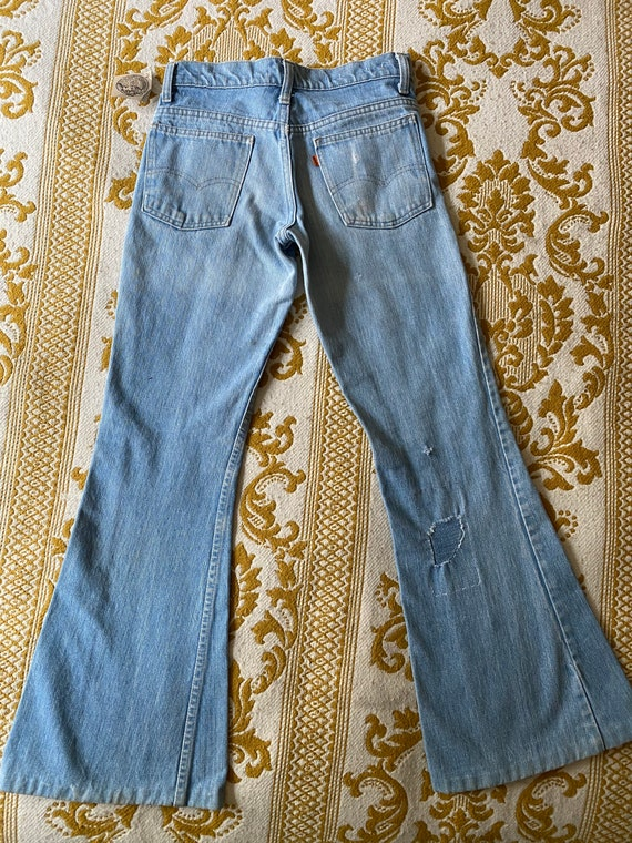 Levi's Orange Tab Bell bottoms with small denim pa
