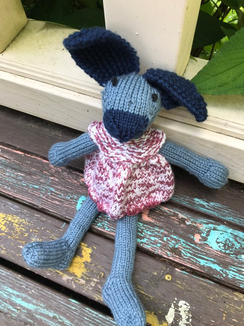 Blue bunny in a pink dress