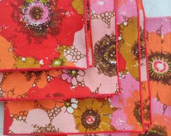 Vintage cotton table napkins, set of four, multicolored floral pattern.