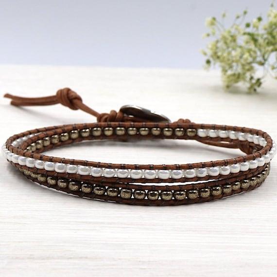 women wrap bracelet with off white miyuki beads and bronze two towers