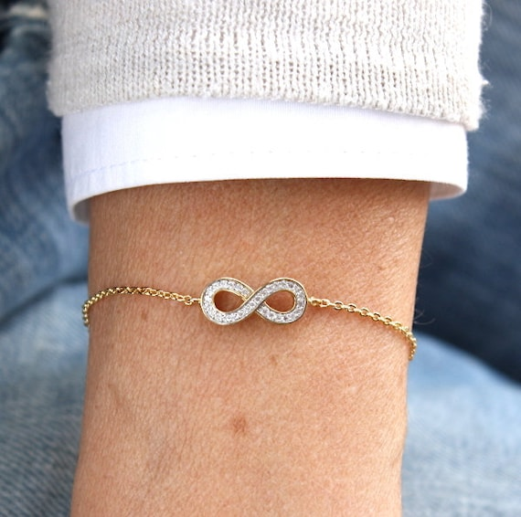 infinite gold-plated bracelet covered with zircons for women