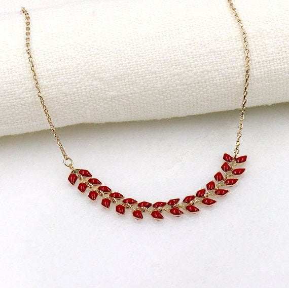 gold-plated woman necklace red enamelled bay leaf