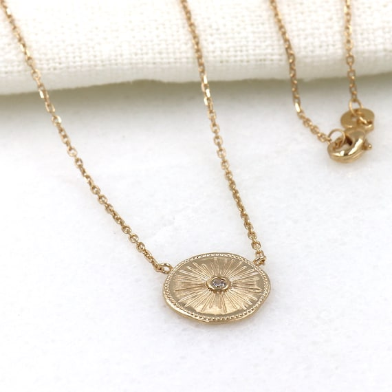 woman necklace plated gold pendant sun and zircon stone