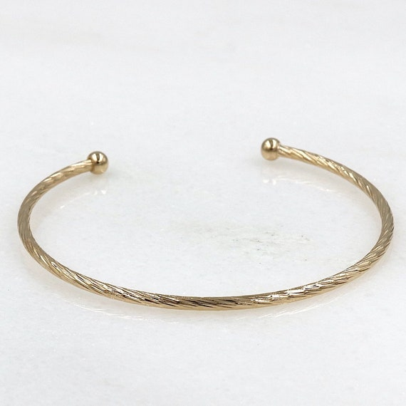 twisted gold-plated bracelet for women