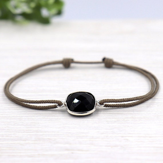 woman set black spinel gem stone cord bracelet