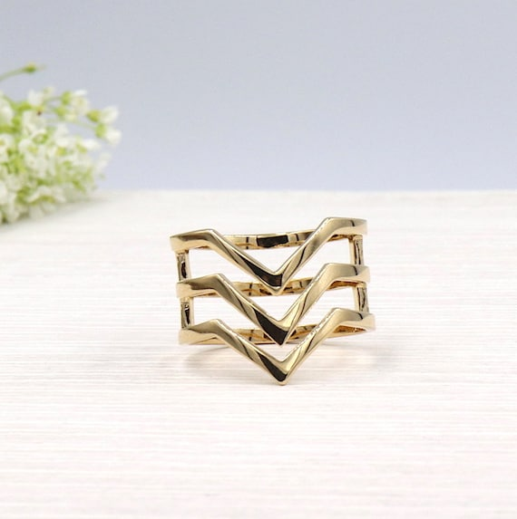 three gold-plated woman ring v