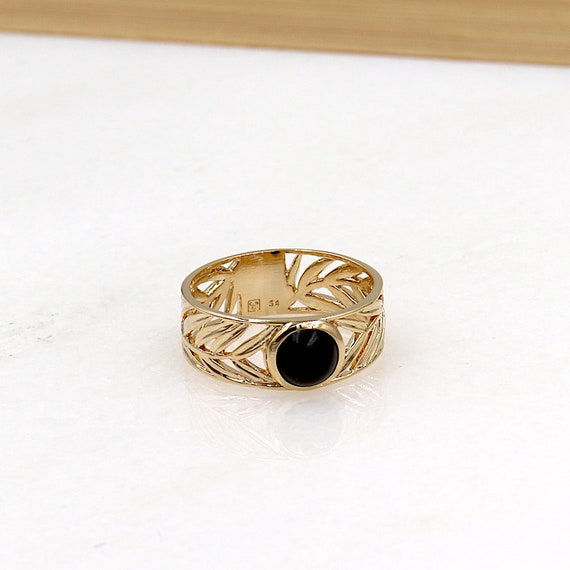 gold-plated ring patterned sheet and black agate stone